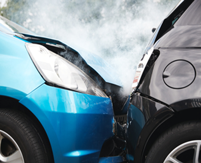 Michael J Bell Law Office, Personal Injury Services. Photo of a blue car crashing into the back of a black car.